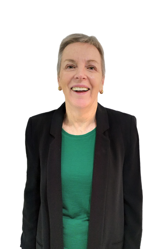 Smiling Lady in green top and black blazer