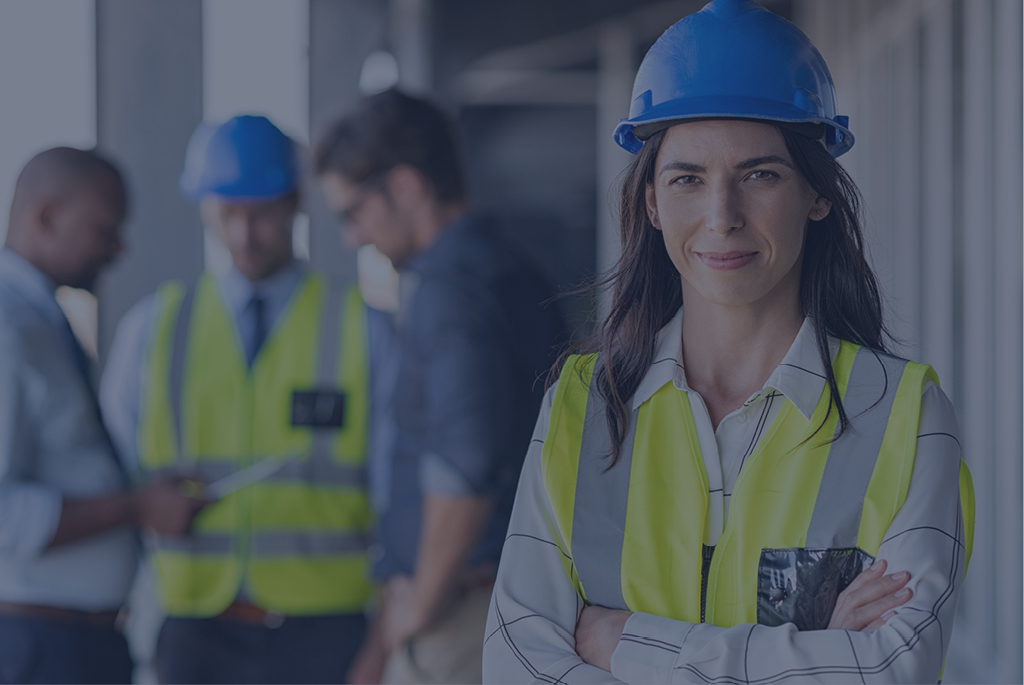 Female lead with hard hat and hi vis vest